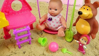 Baby doll and Marsha bear toy sand playground surprise eggs play