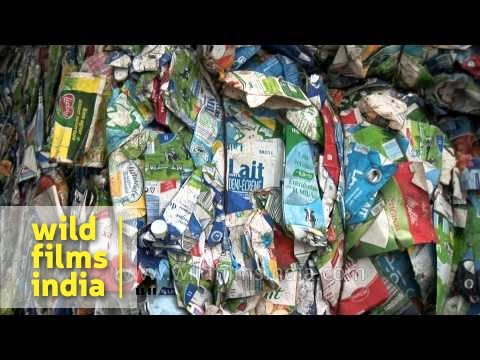 Stack of imported household waste at a recycling yard in India