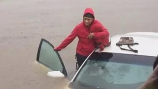 Police Save Mother and Baby from Car Stuck in Flood Caused by Hurricane Matthew