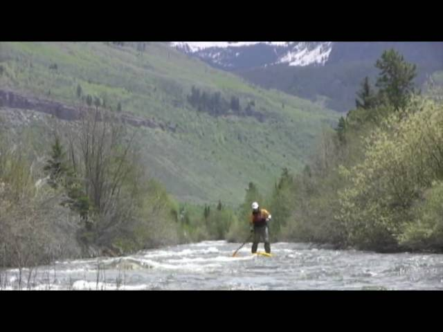 Paddling the Versa Board SUP board on Gore Creek during the Teva Mountain Games