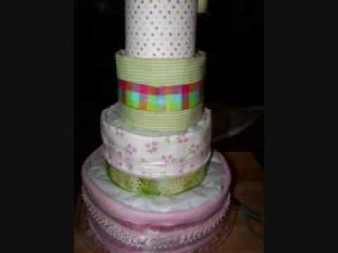 An EASY STEP BY STEP tutorial on how to make a diaper cake. This method hides the diapers and a thoughtful surprise for mom and dad too!