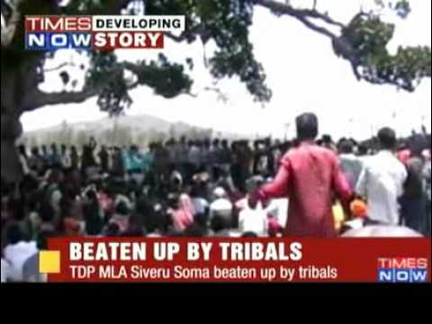 Tribal women beat up TDP MLA - Video   The Times of India.flv