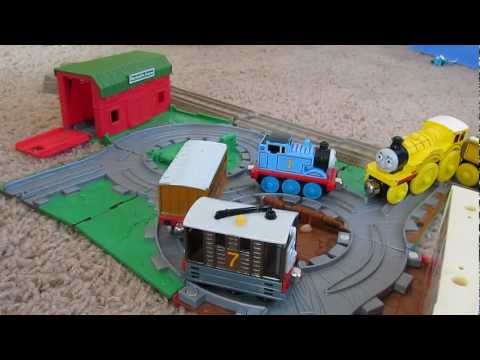 Kid plays with Thomas the Train toys at Farmer McColl's