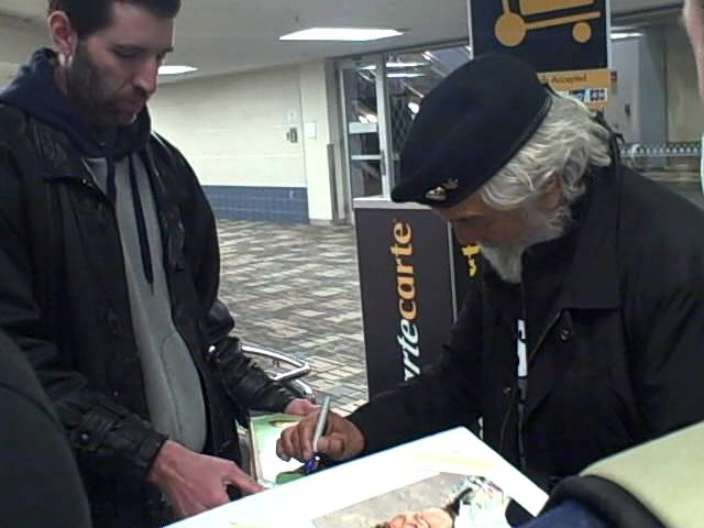 Tommy Chong of Cheech and Chong signing autographs