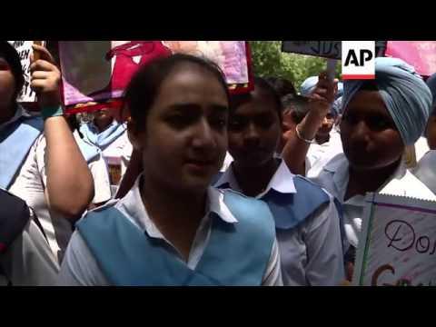 School children march in support of child rape victims