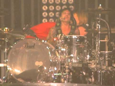 Motley Crue 2013 Winnipeg Tommy Lee takes lucky fan for a ride on his roller coaster drum kit.