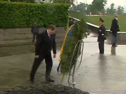 President Viktor Yanukovych of Ukraine Gets knocked on the Head by a Wreath