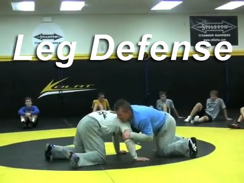 Leg Defense Spin KOLAT.COM Wrestling Techniques Moves Instruction Image 1