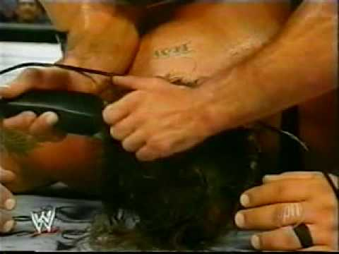 Big Show get's his Head Shaved.