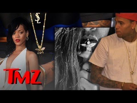 Chris Brown's Wearing Rihanna's Necklace?!?!