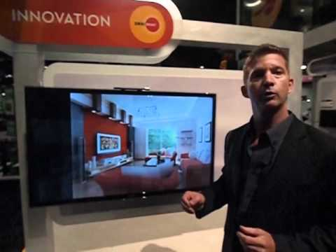 John Deutsch of OmniMount demonstrates the Play40 interactive flat panel mount