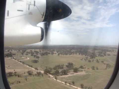 Qantaslink (Qantas) Bombardier Dash 8-300 landing at Melbourne (ymml) international airport on its way back from Devonport regional airport. Sorry about the ...