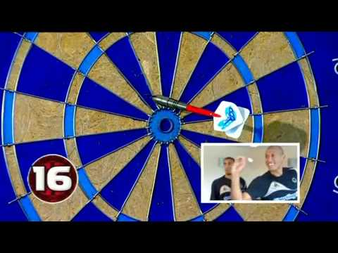 A soccer AM video of wolves centre midfielder Karl Henry and striker Chris Iwelumo battling it out to see who is the darts champion, it's first to hit bullseye, who will hit it first? watch...
