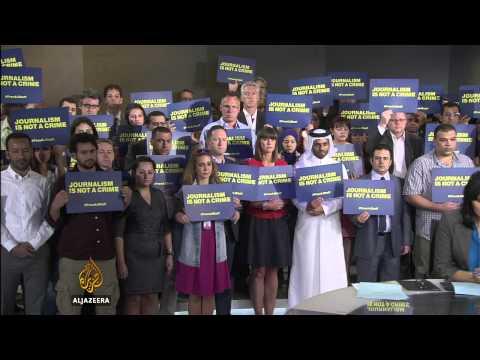 Journalists hold vigil for jailed Al Jazeera staff
