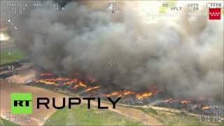 Tire inferno: 9,000 residents evacuated in Spanish town of Sesena , near Madrid, have been ordered t