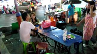 Walk along Hat Yai night food market with two ladyboys - katoeys - waving - 720P HD