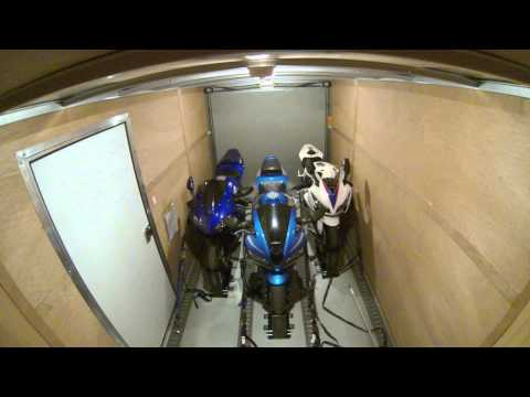 Interior of Enclosed Trailer While Driving with Motorcycles Tied