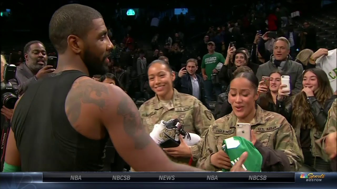 Kyrie Irving gives jersey and shoes to Veterans sitting courtside | ESPN
