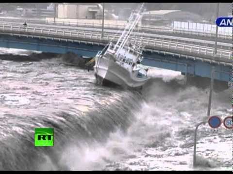This dramatic video shows a tsunami wave smashing into the Japanese town of Miyako, in Iwate Prefecture. The wave crashes over the seawall carrying away ever...