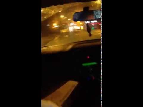 Man driving in car drive by steals a pizza from man waiting for bus home. HILARIOUS!!