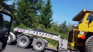 Mack Titan lowboy with Cat 773 off highway dump tr