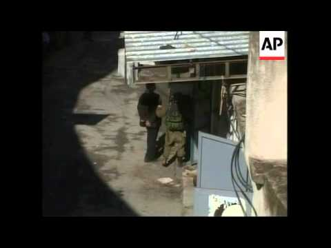 WRAP Israeli troops raid Nablus in search of militants, Jenin funeral; clashes