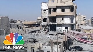 Drone Video Reveals Destruction As Raqqa Is Officially Declared 'Liberated From ISIS' | NBC News