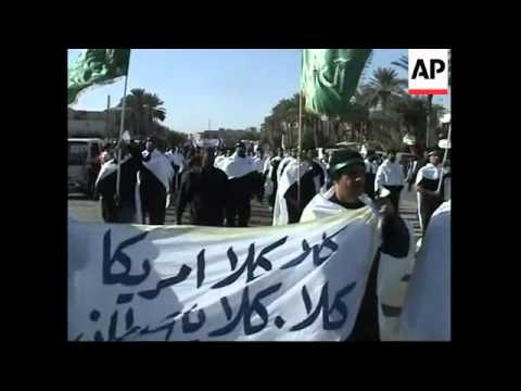 Thousands of followers of radical Shiite cleric Moqtada al-Sadr in march