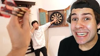 THROWING THREE DARTS AT HIS HAND!! (FREAKOUT)
