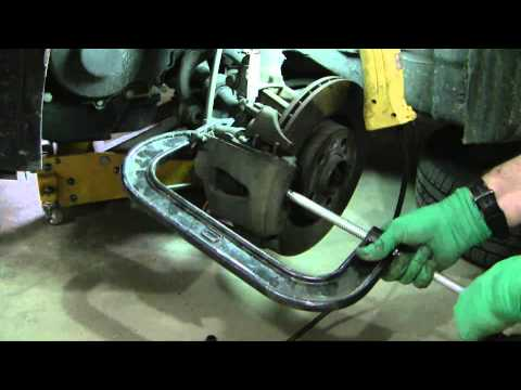Replace front disc brake pads on a 2001 VW Jetta