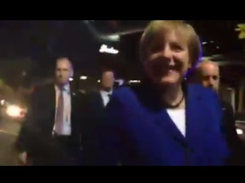 German chancellor Angela Merkel steps out of car to meet Brisbane locals
