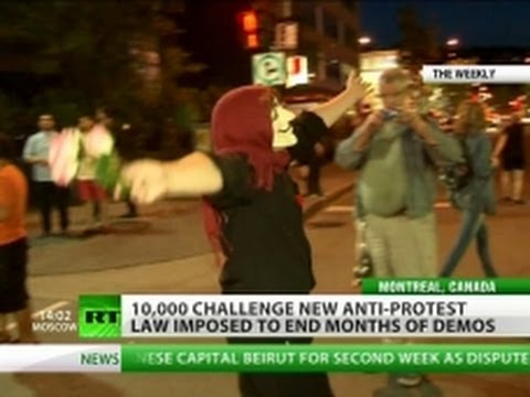 Naked Woman & Guy Fawkes Among 10,000 Canadian Protesters video