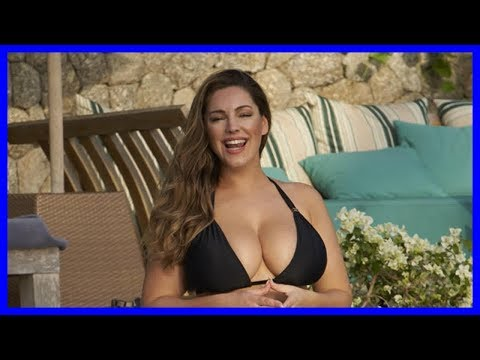 Kelly Brook's bikini struggles to contain her modesty as boobs ooze into public thumbnail
