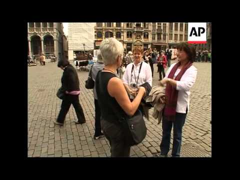 Euro hits record high against dollar, tourist reax in Italy, Belgium, Netherlands