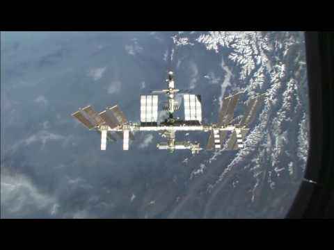 Space Shuttle STS 130: Views of ISS and Earth:  Fly Around The Station