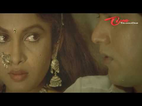 Heroine Ramya Krishna'a Hot Romancing Scene From A Telugu Movie video