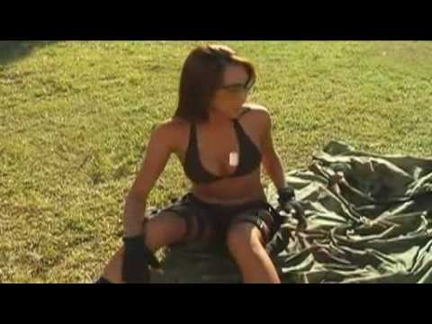 sexy hot girl firing automatic weapon -  Linnea tries  50 cal rifle