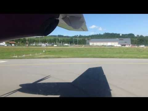 Takeoff from Berne in a Welcome Air Do328