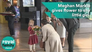 Meghan Markle gives flower to shy little girl at Titanic Belfast