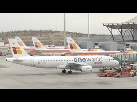 Iberia workers protest at Madrid airport over job cuts