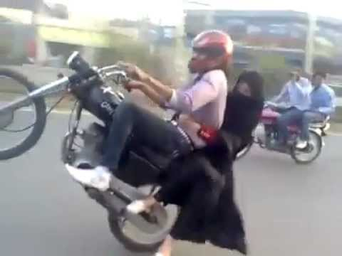 Boy Wheeling On Bike With Girl-Pakistani-Masti