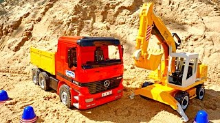 Toy cars: a dump truck and an excavator.