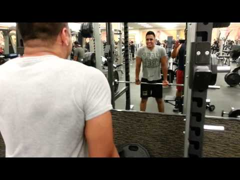 Weight training SHRUGS at the gym Image 1