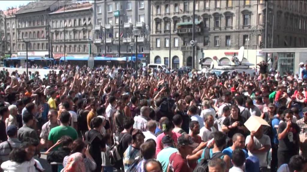 Hundreds of migrants wait in front of the Keleti Railway Station