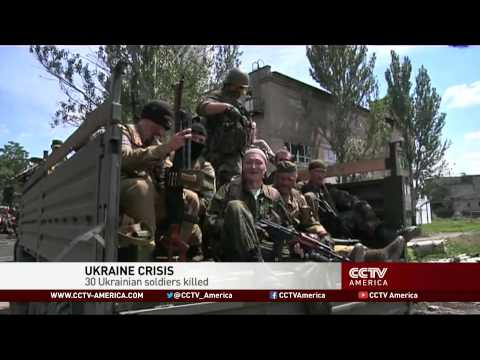 Missile attacks by separatists kill 30 in Ukraine
