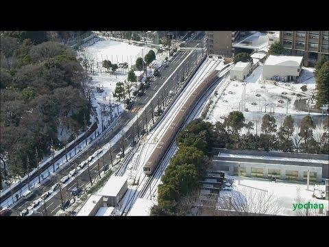 Snow scene and Metro train (Tokyo Metro 02 series).at Marunouchi Line