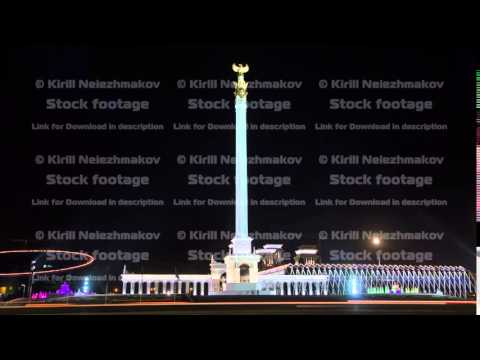 Stele monument Kazakh Eli with bird Samruk and Palace of Independence timelapse hyperlapse at night