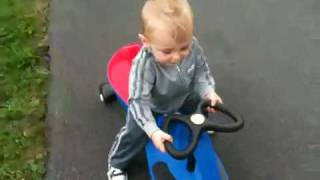 Baby on plasma car and ride on toy