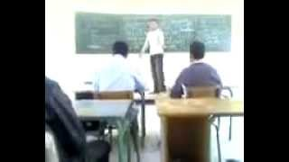 Angry teacher whacks student