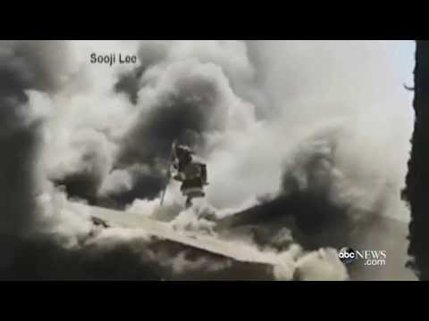 Firefighter's Dangerous Fall Into Fire Caught on Video
